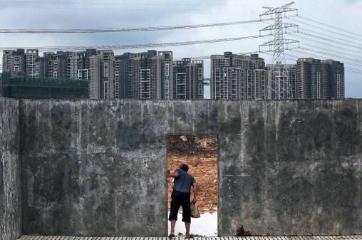 专家:农民工到三四线城市买房 月工资得达5千