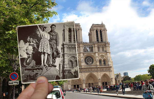 一个年轻女孩和士兵一起站在坦克车上,身后是世界上最出名的哥特式建筑(之一),巴黎圣母院。现在占领它的还是游客。