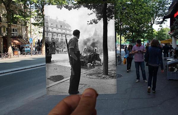 一位行人在圣米歇尔一边走一边玩手机。1940年,在他身旁的位置,曾经烧掉过一辆车。