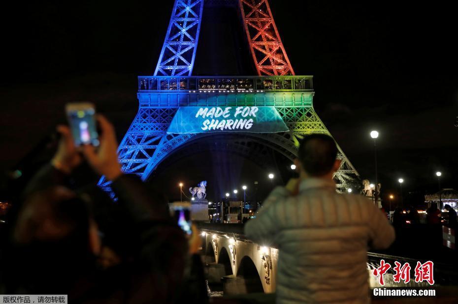 埃菲尔铁塔点亮奥林匹克会旗灯光 争2024年奥运主办权