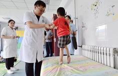 """透视残疾儿童康复救助制度:拯救""""折翼的天使"""""""
