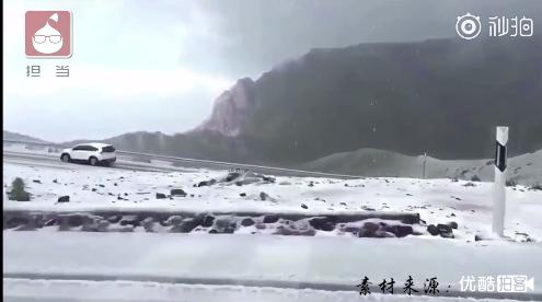 新疆降雪怎么回事?新疆8月为什么会下雪?短袖棉衣切换自如
