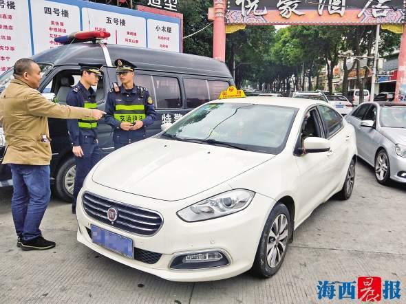"""私家车头顶""""出租""""载客被罚五千 涉事车辆被依法暂扣"""