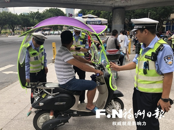 电动车加装遮阳伞,拆除并罚款!