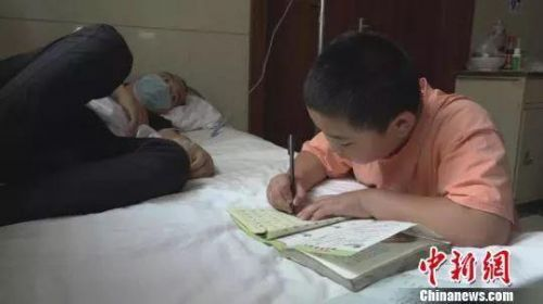 增肥救父男孩陪父赴京治疗怎么回事?11岁男孩增肥救父始末最新消息
