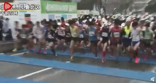 东京奥运如期举行 日本近10万人参加马拉松大赛