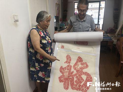 78岁老党员历时一年绘制39米长印章画卷